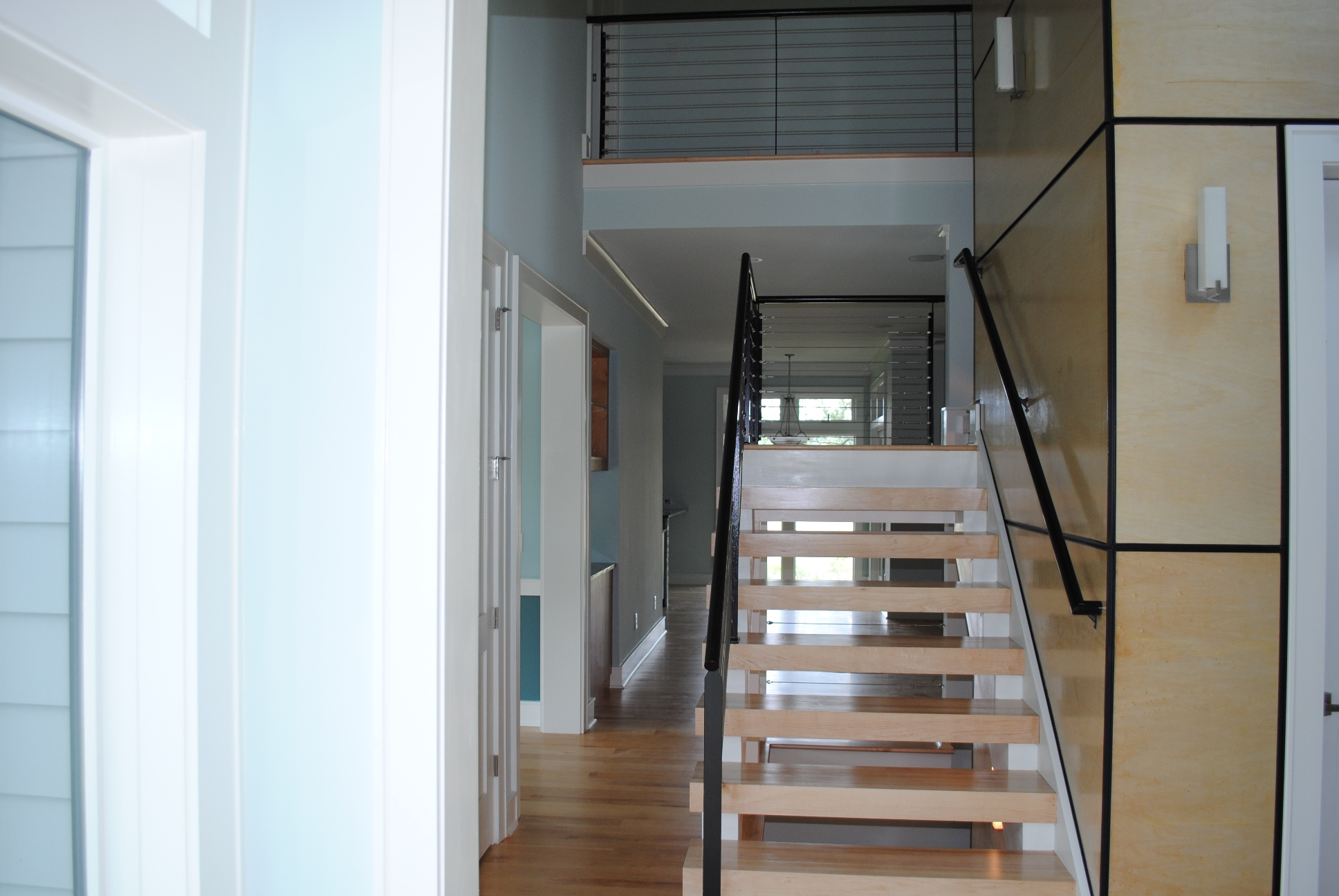 custom staircase at new home by Madigan Projects