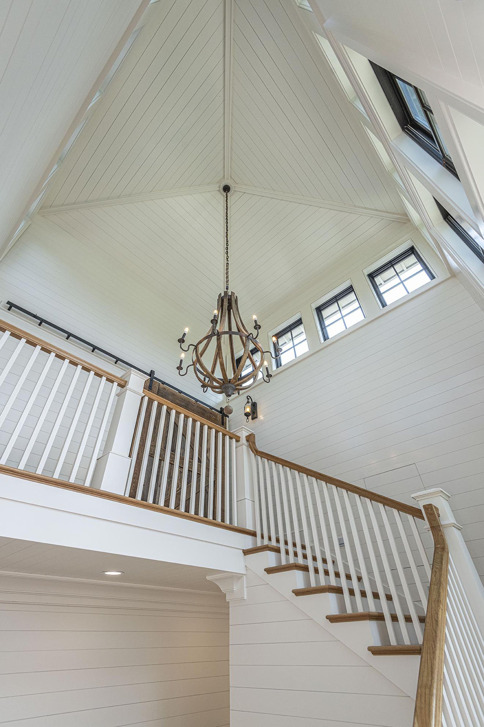 custom stairway with hanging chandelier at new custom home