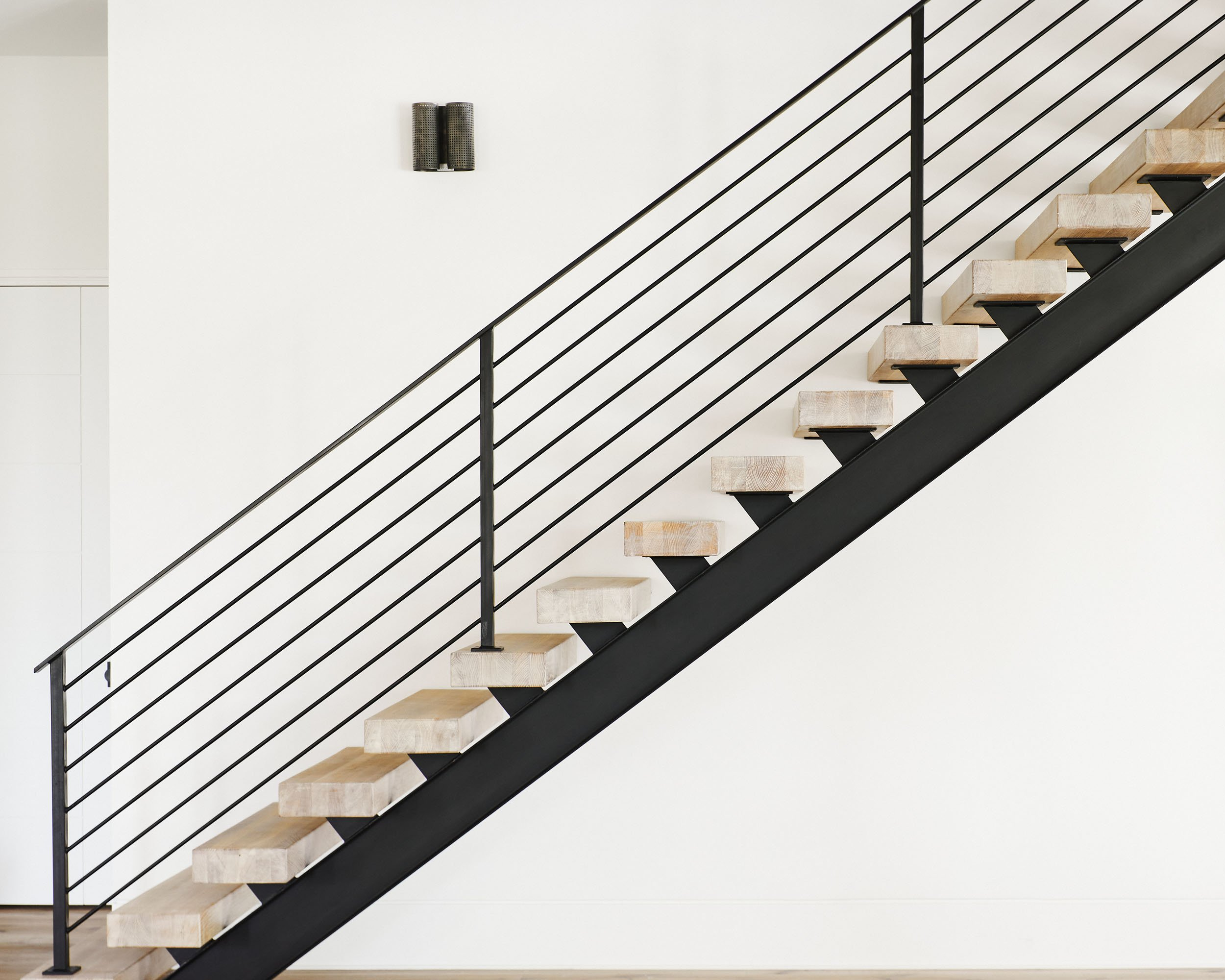 custom staircase in new home by Madigan Projects